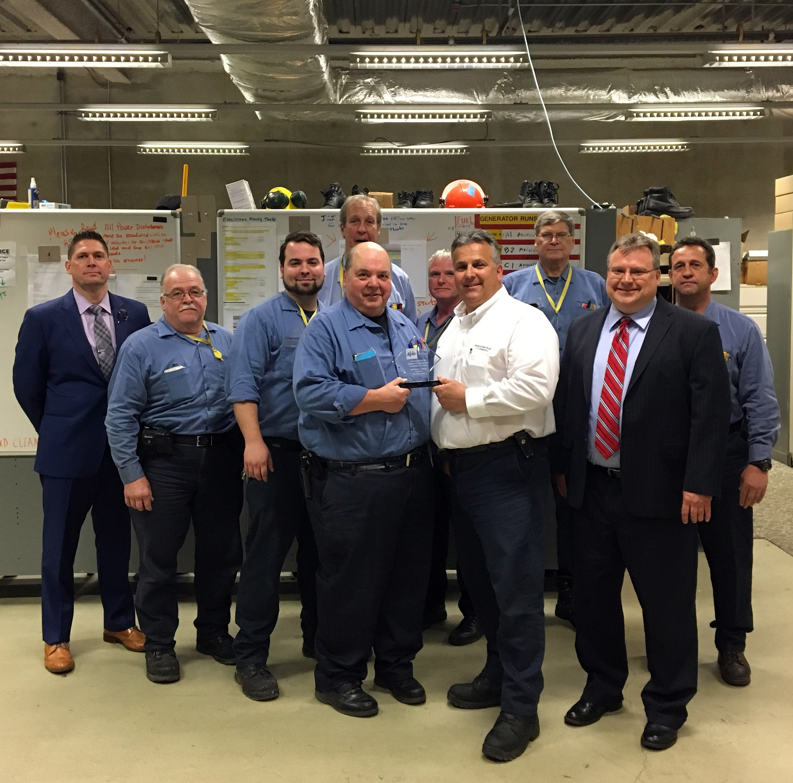 The New Jersey team holding an award for safety